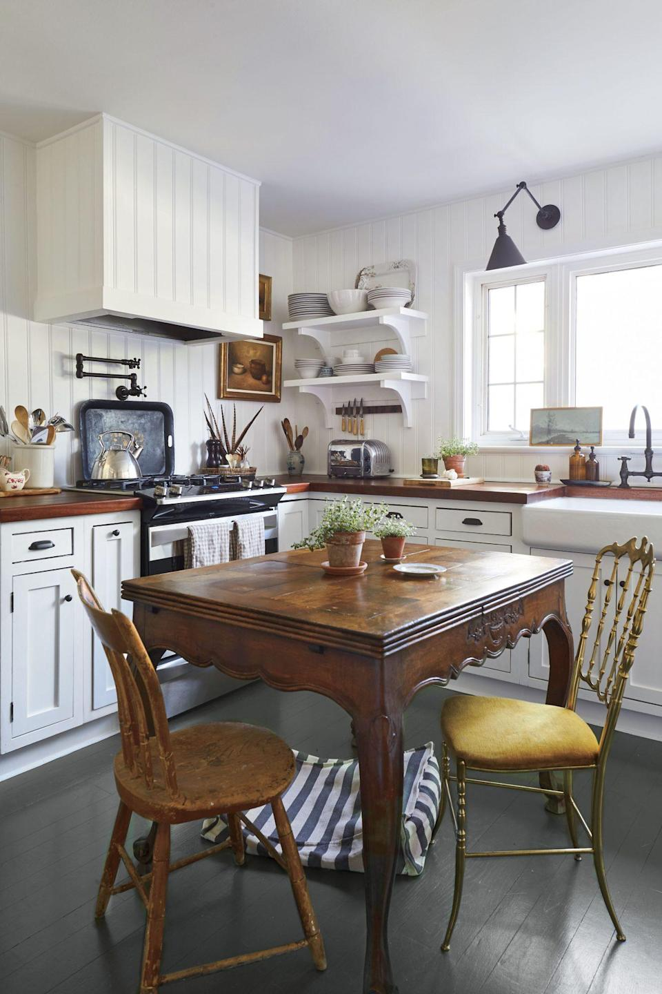 """<p>Designer Olivia Brock worked with Hanna Seabrook to give these hardwood floors instant character by painting them <a href=""""https://www.benjaminmoore.com/en-us/color-overview/find-your-color/color/cw-85/randolph-gray?color=CW-85"""" rel=""""nofollow noopener"""" target=""""_blank"""" data-ylk=""""slk:this deep green-gray"""" class=""""link rapid-noclick-resp"""">this deep green-gray</a>, topped with an exterior Arborcoat finish for durability. See more <a href=""""https://www.southernliving.com/home/before-after/first-home-decor-ideas"""" rel=""""nofollow noopener"""" target=""""_blank"""" data-ylk=""""slk:here"""" class=""""link rapid-noclick-resp"""">here</a>.</p>"""