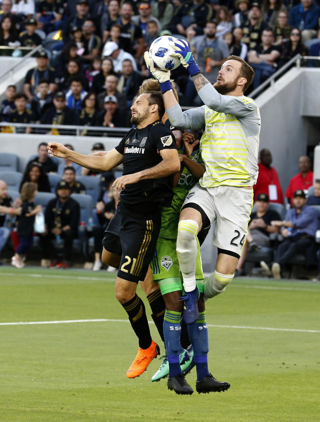 Seattle Sounders goalkeeper Stefan Frei (24), of Switzerland, catches the ball against Los Angeles FC forward Marco Urena (21), of Costa Rica, in the first half of an MLS soccer game at Banc of California Stadium in Los Angeles, Sunday, April 29, 2018. (AP Photo/Ringo H.W. Chiu)