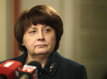 Newly appointed Prime Minister Straujuma listens to a question during a news conference in Riga