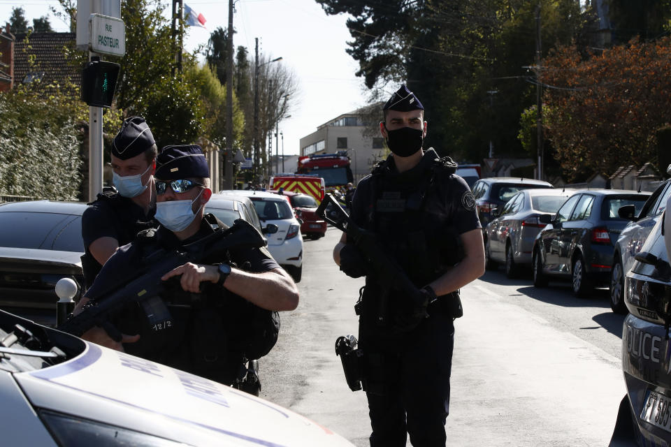 Police officers block the access next to the Police station in Rambouillet, south west of Paris, Friday, April 23, 2021. A French police officer was stabbed to death inside her police station Friday near the famed historic Rambouillet chateau, and her attacker was shot and killed by officers at the scene, authorities said. The identity and the motive of the assailant were not immediately clear, a national police spokesperson told The Associated Press. The police officer was a 49-year-old administrative employee in the station, the spokesperson said. (AP Photo/Michel Euler)