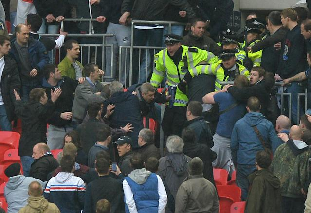Millwall fans clash with police the crowd during the FA Cup semi-final football match between Millwall and Wigan Athletic at Wembley Stadium in north London on April 13, 2013. Wigan won the game 2-0. AFP PHOTO/PAUL ELLIS NOT FOR MARKETING OR ADVERTISING USE / RESTRICTED TO EDITORIAL USEPAUL ELLIS/AFP/Getty Images