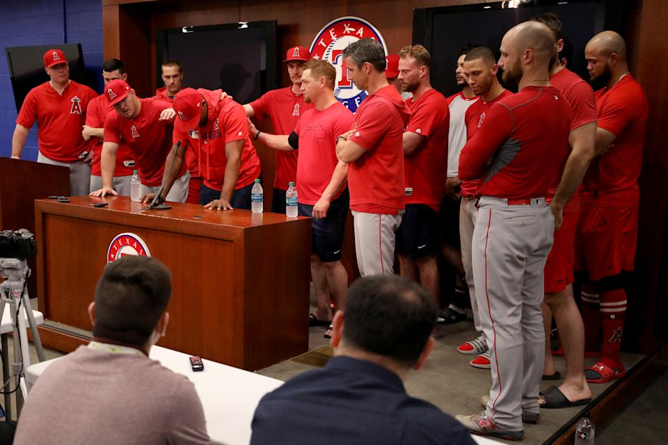 ARLINGTON, TEXAS - JULY 02: Mike Trout #27 of the Los Angeles Angels, Justin Upton #8 of the Los Angeles Angels and Kole Calhoun #56 of the Los Angeles Angels talk with the media about the death of teammate Tyler Skaggs at Globe Life Park in Arlington on July 02, 2019 in Arlington, Texas. (Photo by Tom Pennington/Getty Images)