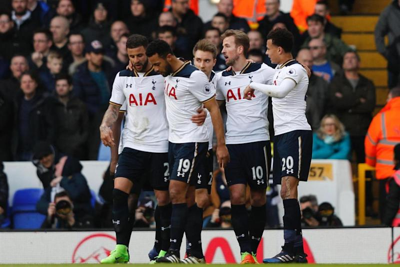 Opener: Tottenham players celebrate Kane's first-half strike