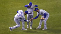 Toronto Blue Jays outfielders Lourdes Gurriel Jr., Jonathan Davis and Randal Grichuk, from left, celebrate after the Blue Jays defeated the Boston Red Sox 6-3 in a baseball game at Fenway Park, Wednesday, April 21, 2021, in Boston. (AP Photo/Charles Krupa)