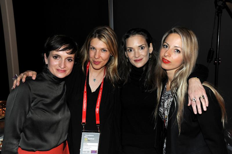"""Director Crystal Moselle (R) and Megan Delaney (L) of """"The Wolfpack"""" pose with actress Winona Ryder (2nd L) at the Awards Night Ceremony of the 2015 Sundance Film Festival on January 31, 2015 in Park City, Utah (AFP Photo/Clayton Chase)"""