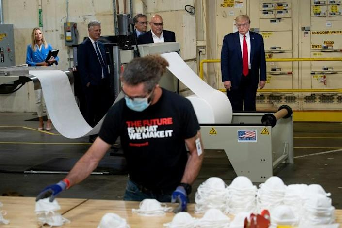 Workers making masks at Honeywell in Phoenix all wear masks, but US President Donald Trump and his entourage did not (AFP Photo/Brendan Smialowski)