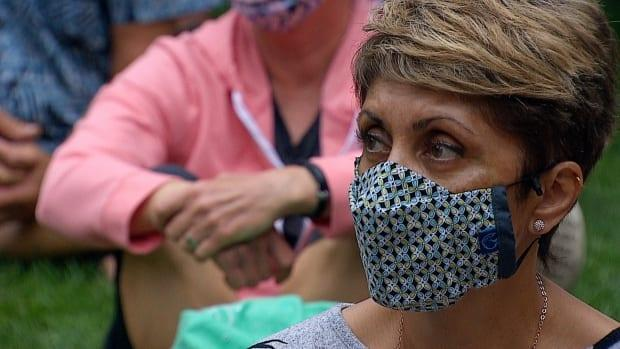 Coun. Jyoti Gondek listens during a protest against the Alberta government's decision to remove COVID-19 health measures in Calgary on Monday, Aug. 2, 2021. (Julie Debeljak/CBC - image credit)