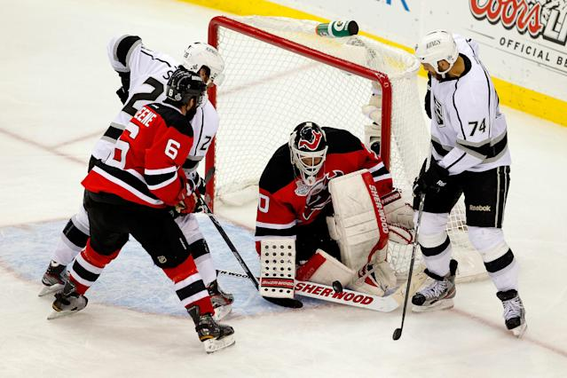 NEWARK, NJ - JUNE 09: Martin Brodeur #30 of the New Jersey Devils makes a save in front of Jarret Stoll #28, Dwight King #74 and Andy Greene #6 during Game Five of the 2012 NHL Stanley Cup Final at the Prudential Center on June 9, 2012 in Newark, New Jersey. (Photo by Paul Bereswill/Getty Images)