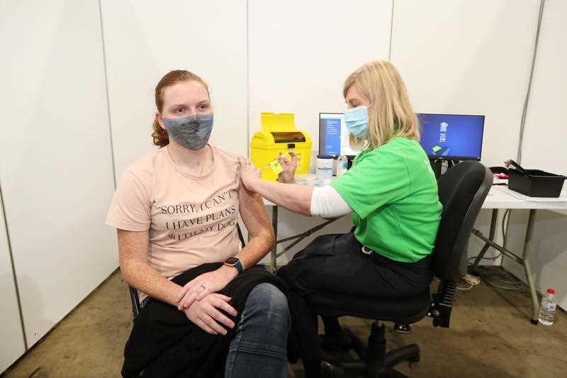 Whitney McIntosh, 27, receives a Pfizer vaccine jab at the COVID-19 vaccination hub at Brisbane Convention and Exhibition Centre in Brisbane.