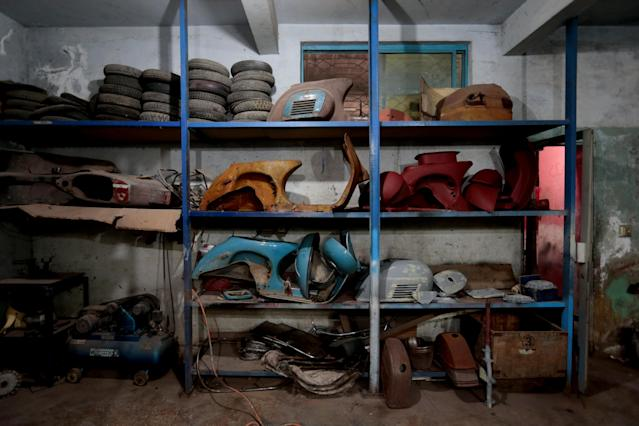 <p>Disassembled Vespa scooters rest on shelves in different states of restoration, at a Vespa restoration and repair workshop in Islamabad, Pakistan March 6, 2018. (Photo: Caren Firouz/Reuters) </p>