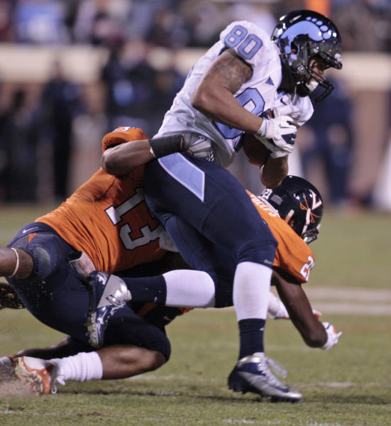 North Carolina tight end Jack Tabb (80) tries to break the tackle of Virginia linebacker Daquan Romero (13) during the first half of an NCAA college football game at Scott stadium Thursday, Nov. 15, 2012 in Charlottesville, VA (AP Photo/Steve Helber)