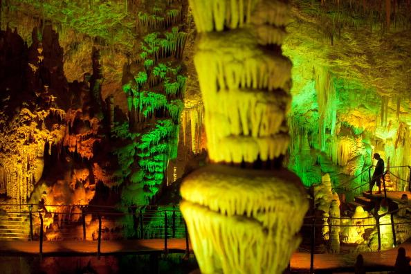A visitor at the Sorek stalactites cave as it is illuminated with a new lighting system on August 9, 2012 near Beit Shemesh, Israel. The cave, 82 meters long and 60 meters wide, was discovered accidentally by workers blasting at the nearby quarry in 1968. (Photo by Uriel Sinai/Getty Images)
