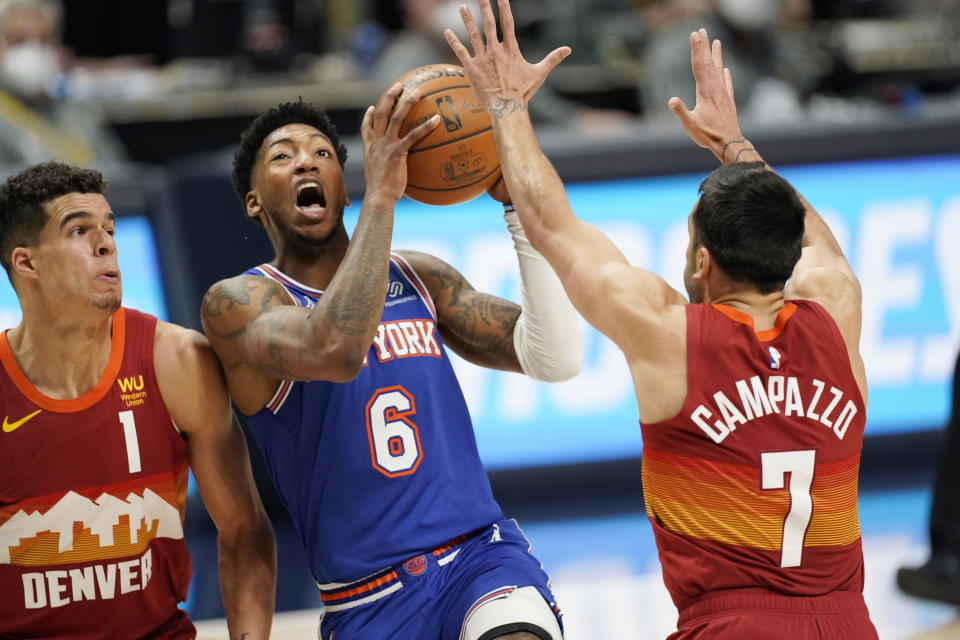 New York Knicks guard Elfrid Payton (6) drives to the rim between Denver Nuggets forward Michael Porter Jr. (1) and guard Facundo Campazzo (7) in the second half of an NBA basketball game Wednesday, May 5, 2021, in Denver. (AP Photo/David Zalubowski)