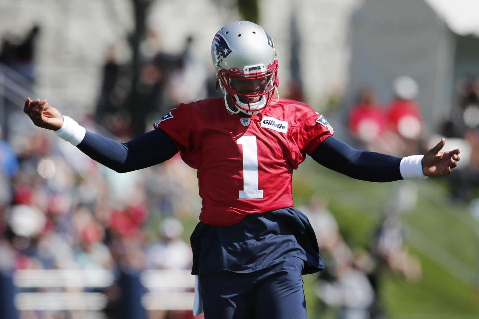 New England Patriots quarterback Cam Newton reacts during an NFL football practice, Saturday, July 31, 2021, in Foxborough, Mass. (AP Photo/Michael Dwyer)