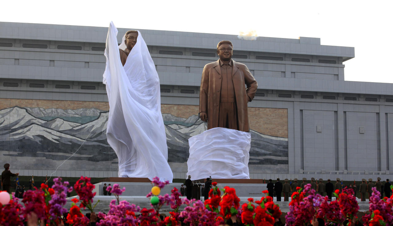 North Korean leaders attend the unveiling ceremony for statues of late leaders Kim Il Sung, left, and Kim Jong Il, right, on Mansudae in Pyongyang, North Korea, Friday, April 13, 2012. (AP Photo/Ng Han Guan)