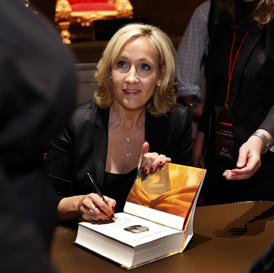 """Author J.K. Rowling signs copies of her book """"Harry Potter and the Deathly Hallows"""" in this Oct. 19, 2007, file photo during the final stop on the """"J.K. Rowling Open Book Tour"""" held at Carnegie Hall in New York City."""