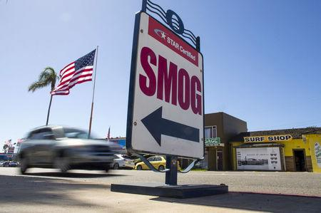 FILE PHOTO: Cars drive past a California emissions testing site in Oceanside