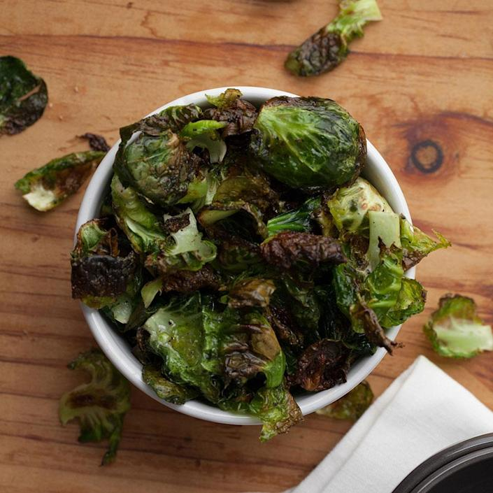 <p>If you like kale chips you're going to love these Brussels sprout chips. Nutritional yeast adds cheesy flavor to this vegan recipe that crisps up the outer leaves of Brussels sprouts in the oven in just 10 minutes for a healthy snack. But don't throw out the sprout innards--they're great for roasting as a side for dinner.</p>