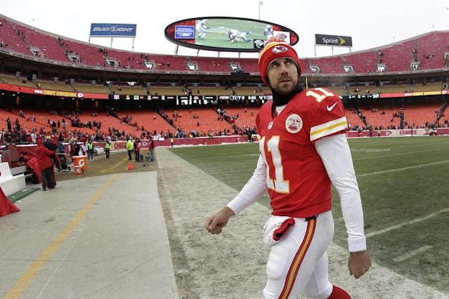 Kansas City Chiefs quarterback Alex Smith walks off the field after an NFL football game against the Indianapolis Colts on Sunday, Dec. 22, 2013, in Kansas City, Mo. The Colts won 23-7. (AP Photo/Charlie Riedel)