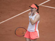 Slovenia's Tamara Zidansek celebrates after winning a point against Romania's Sorana Cirstea during their fourth round match on day 8, of the French Open tennis tournament at Roland Garros in Paris, France, Sunday, June 6, 2021. (AP Photo/Christophe Ena)