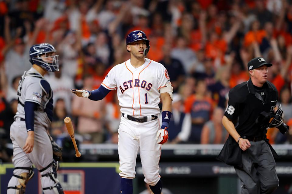 HOUSTON, TX - OCTOBER 13:  Carlos Correa #1 of the Houston Astros drops his bat after hitting a walk off home run in the 11th inning to beat the New York Yankees in Game 2 of the ALCS at Minute Maid Park on Sunday, October 13, 2019 in Houston, Texas. (Photo by Alex Trautwig/MLB Photos via Getty Images)