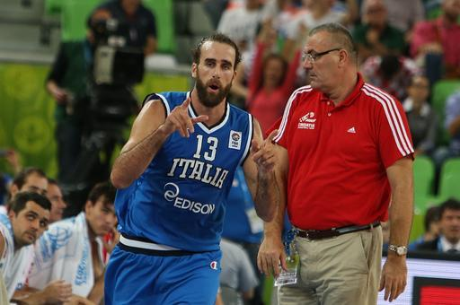 Italy's Luigi Datome, left, reacts after scoring a two-point shot as Croatia's coach Jasmin Repesa looks on during their EuroBasket European Basketball Championship Group F match at the Stozice Arena, in Ljubljana, Slovenia, Saturday, Sept. 14, 2013. (AP Photo/Thanassis Stavrakis)