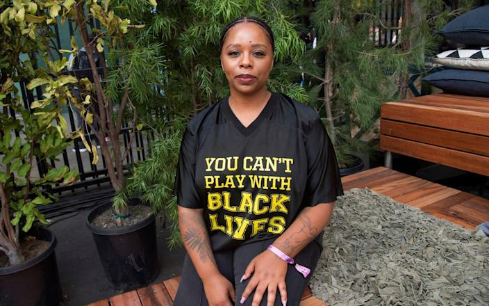 Patrisse Cullors poses for a photo - Amy Harris /Invision/AP