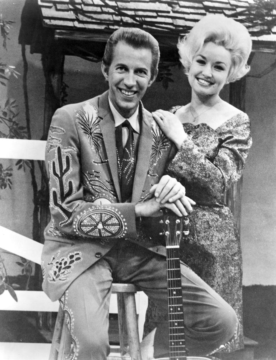 "<p>Much of Dolly's early success is do to her spot on Porter Wagoner's television series <em>The Porter Wagoner Show</em>. The two become close and often sang duets together. When Dolly eventually left the show to pursue a solo career, she wrote her famous song ""I Will Always Love You"" about saying goodbye to her old friend.</p><p><strong>RELATED:</strong> <a href=""https://www.goodhousekeeping.com/life/entertainment/a30570197/dolly-parton-i-will-always-love-you-lyrics-meaning/"" rel=""nofollow noopener"" target=""_blank"" data-ylk=""slk:The Real Story Behind Why Dolly Parton Wrote the Song &quot;I Will Always Love You&quot;"" class=""link rapid-noclick-resp"">The Real Story Behind Why Dolly Parton Wrote the Song ""I Will Always Love You""</a></p>"