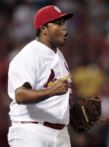 St. Louis Cardinals relief pitcher Victor Marte celebrates after striking out Chicago Cubs' Reed Johnson with the bases loaded to end the top of the seventh inning of a baseball game, Monday, May 14, 2012, in St. Louis. (AP Photo/Jeff Roberson)