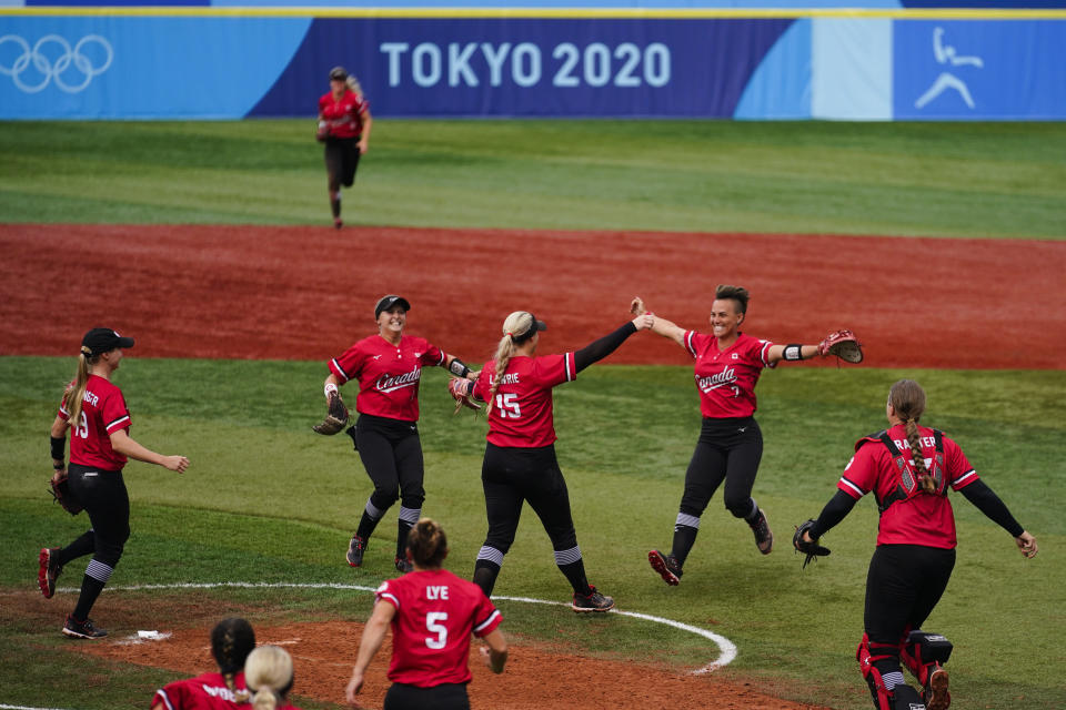 Members of team Canada celebrate after a softball game against Mexico at the 2020 Summer Olympics, Tuesday, July 27, 2021, in Yokohama, Japan. Canada won 3-2. (AP Photo/Matt Slocum)
