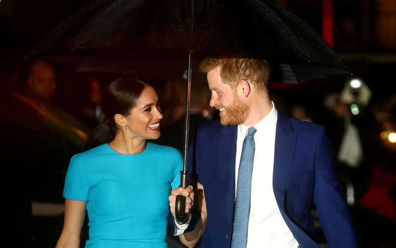 FILE PHOTO: Britain's Prince Harry and his wife Meghan, Duchess of Sussex, arrive at the Endeavour Fund Awards in London