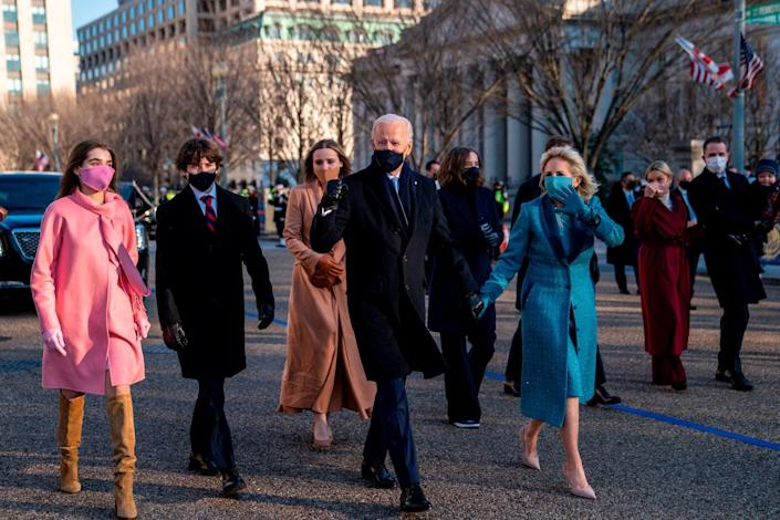 <p>For the post-Inauguration parade, Joe and Jill held hands to lead their large group, which included their grandchildren (from left, Natalie, Hunter and Finnegan).</p>