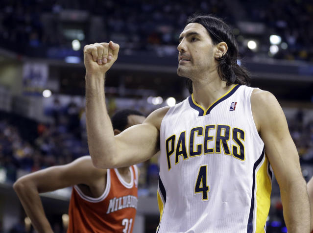 Indiana Pacers forward Luis Scola celebrates a foul called against the Milwaukee Bucks in the second half of an NBA basketball game in Indianapolis, Friday, Nov. 15, 2013. The Pacers defeated the Bucks 104-77. (AP Photo/Michael Conroy)