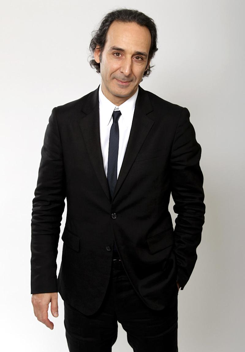"FILE - In this Feb. 4, 2013 file photo, Oscar nominee Alexandre Desplat poses for a portrait at the 2013 Oscar Nominee Luncheon, in Los Angeles. The film academy announced Thursday, Feb. 13, 2014, it plans to present a live Oscar Concert celebrating the year's nominated composers, including Desplat for ""Philomena."" Besides music from ""Gravity,"" ""The Book Thief,"" ""Saving Mr. Banks,"" ""Philomena"" and ""Her,"" the program will include performances of the four original songs up for Oscars this year. (Photo by Matt Sayles/Invision/AP, file)"