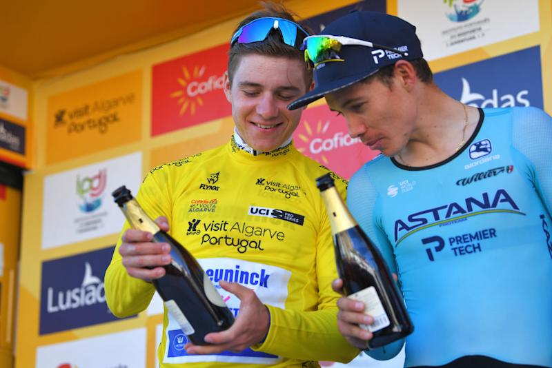LAGOA PORTUGAL FEBRUARY 23 Podium Remco Evenepoel of Belgium and Team Deceuninck Quick Step Yellow Leader Jersey Miguel ngel Lpez of Colombia and Team Astana Pro Team Celebration Champagne during the 46th Volta ao Algarve 2020 Stage 5 a 203km Individual Time Trial stage from Lagoa to Lagoa ITT VAlgarve2020 on February 23 2020 in Lagoa Portugal Photo by Tim de WaeleGetty Images