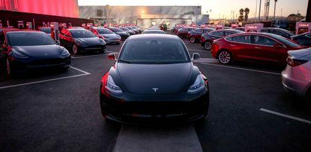 Tesla Model 3 cars are seen as Tesla holds an event at the factory handing over its first 30 Model 3 vehicles to employee buyers at the company's Fremont facility in California, U.S., July 28, 2017. Courtesy Tesla/Handout via REUTERS