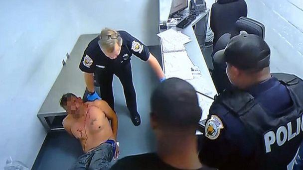PHOTO: An image made from surveillance footage from inside the Homestead, Fla., police department shows Homestead Police officer Lester Brown pushing an inmate into a wall on Dec. 1, 2018. (WPLG)