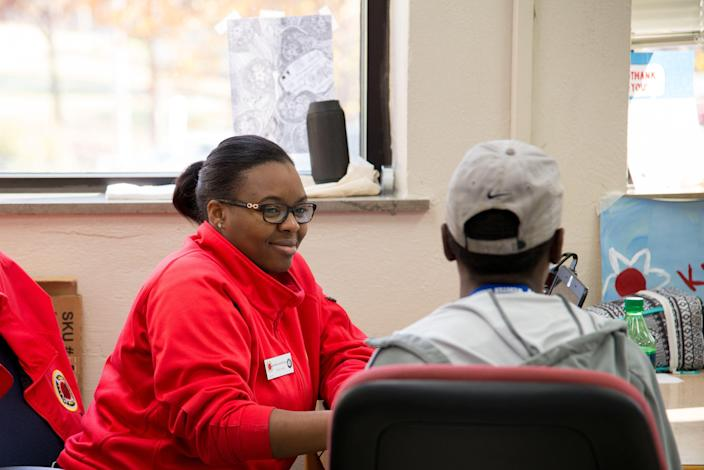 Keanna Marshall, a City Year team leader works with a student at a school in Tulsa, Oklahoma, in 2017.