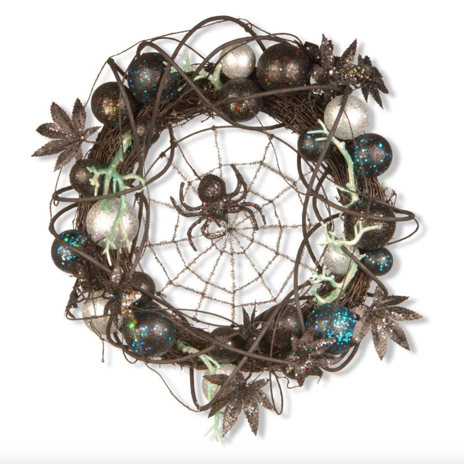 """<p><strong>BUY IT:</strong> $37.99; <a href=""""https://goto.walmart.com/c/249354/565706/9383?subId1=SLSpookyHalloweenWreathsforYourFrontDoorpshannon1271HalGal7869001202009I&u=https%3A%2F%2Fwww.walmart.com%2Fip%2F18-Halloween-Wreath%2F51662358"""" target=""""_blank"""">walmart.com</a></p> <p>A little bit of glitter, a few creepy crawlies, and a whole lot of festive. Grab this 18-inch vine-covered wreath with foliage and a menacing spider front and center for guaranteed shrieks.</p>"""