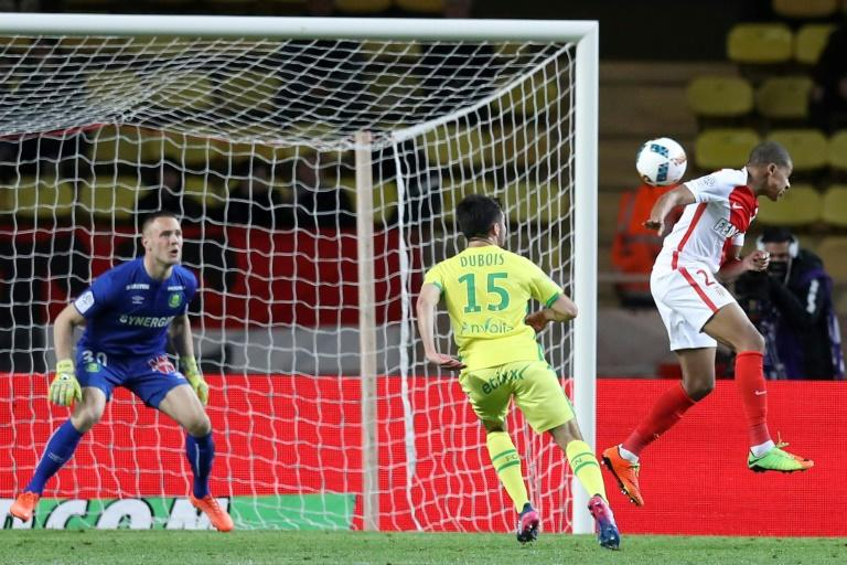 "Monaco's French forward Kylian Mbappe Lottin (R) scores a goal during the French L1 football match Monaco (ASM) vs Nantes (FCN) on March 5, 2017 at the ""Louis II Stadium"" in Monaco"