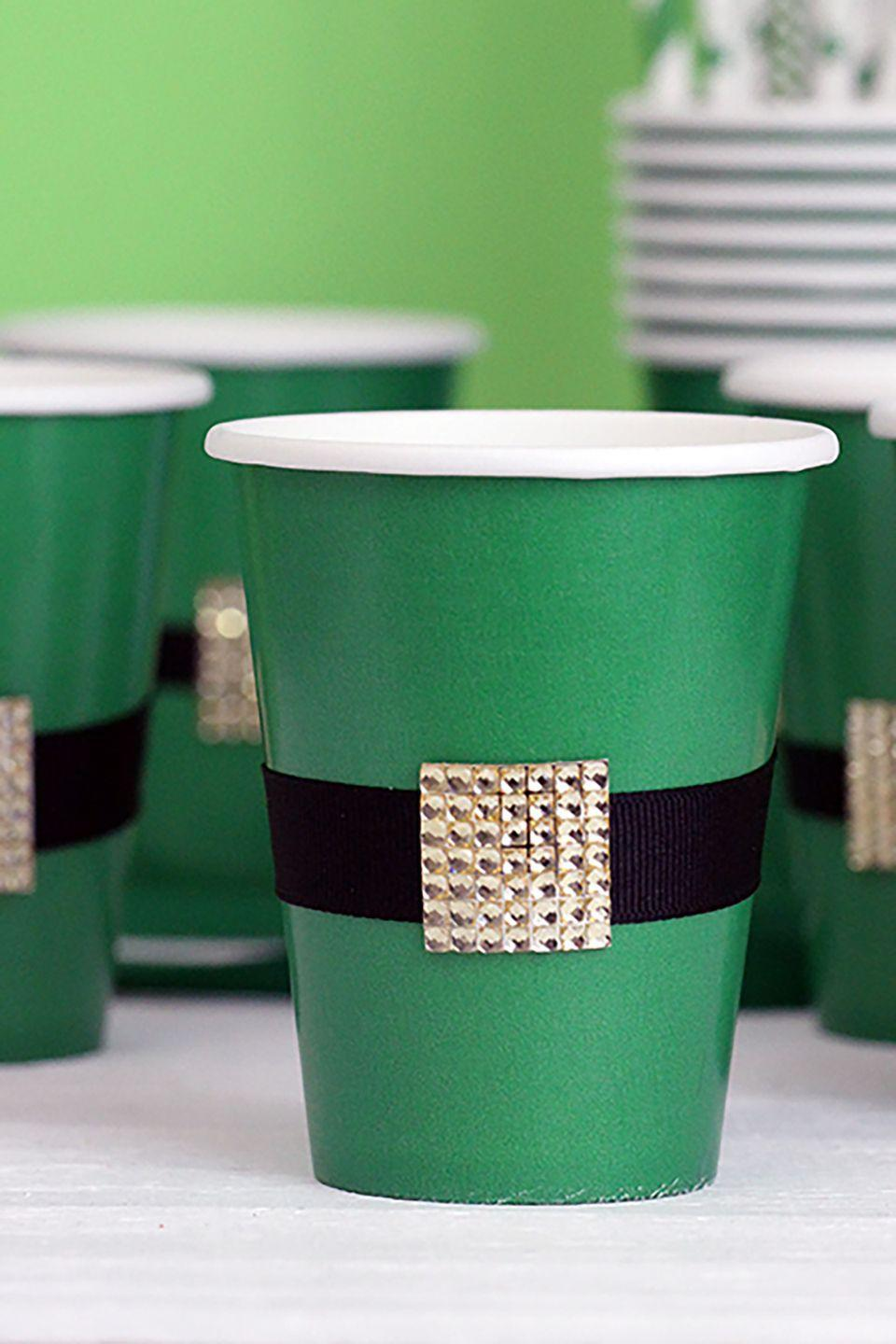 """<p>Forget red solo cups, and go for these spirited cups instead.</p><p><strong>Get the tutorial at <a href=""""http://cutefetti.com/2015/03/diy-leprechaun-belt-cups.html"""" rel=""""nofollow noopener"""" target=""""_blank"""" data-ylk=""""slk:Cutefetti"""" class=""""link rapid-noclick-resp"""">Cutefetti</a>. </strong></p><p><a class=""""link rapid-noclick-resp"""" href=""""https://www.amazon.com/SparkSettings-Disposable-Drinking-Beverages-Perfect/dp/B07JN6ZZ2F/ref=sr_1_1_sspa?tag=syn-yahoo-20&ascsubtag=%5Bartid%7C10050.g.4036%5Bsrc%7Cyahoo-us"""" rel=""""nofollow noopener"""" target=""""_blank"""" data-ylk=""""slk:SHOP PAPER CUPS"""">SHOP PAPER CUPS</a></p>"""