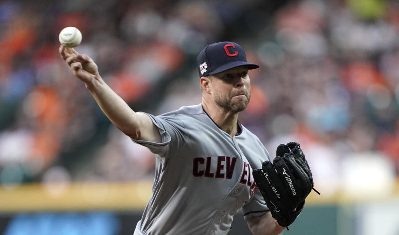 FILE - In this April 26, 2019, file photo, Cleveland Indians starting pitcher Corey Kluber throws against the Houston Astros during the first inning of a baseball game in Houston. Klubers broken arm is healing as hoped and he could soon be throwing bullpen sessions. He sustained a fractured ulna when he was struck by a line drive on May 1 in Miami. (AP Photo/David J. Phillip, File)