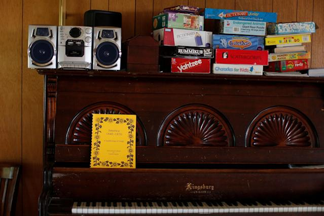 <p>A piano and games are seen in the United Methodist Church in which immigrant Rosa Sabido, 53, lives while facing deportation in Mancos, Colo., July 19, 2017. (Photo: Lucy Nicholson/Reuters) </p>