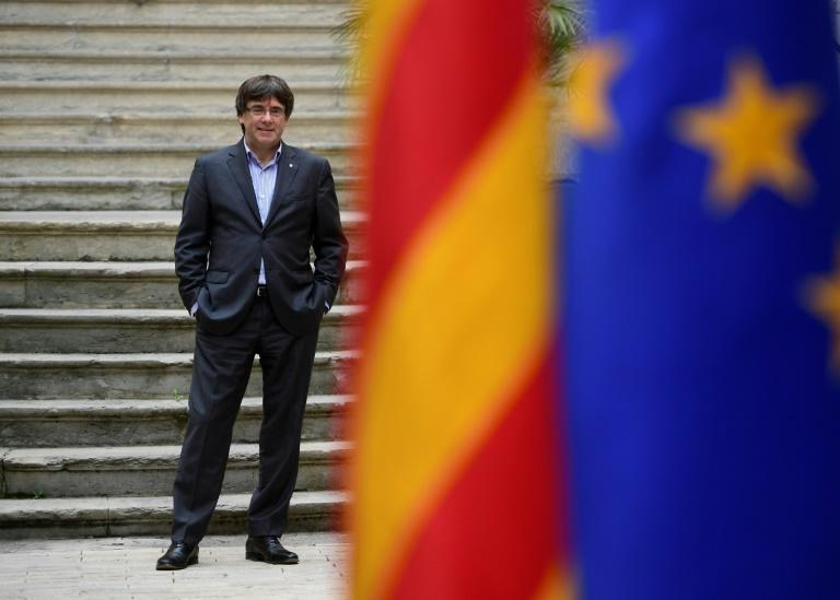 Catalonia's dismissed leader Carles Puigdemont was due to give a press conference in Brussels on Tuesday