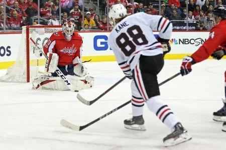 Dec 6, 2017; Washington, DC, USA; Washington Capitals goalie Braden Holtby (70) makes a save on Chicago Blackhawks right wing Patrick Kane (88) in the second period at Capital One Arena. Mandatory Credit: Geoff Burke-USA TODAY Sports