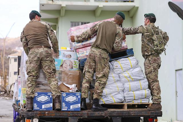 <p>British troops from 40 Commando prepare aid for distribution, on the British Virgin Islands, Road Town, Virgin Islands , Sept. 18, 2017. Royal Marines from 40 Commando have been ensuring aid reaches people across the island before Storm Maria arrives. (Photo: Photo by LPhot Joel Rouse/Handout/EPA-EFE/REX/Shutterstock) </p>