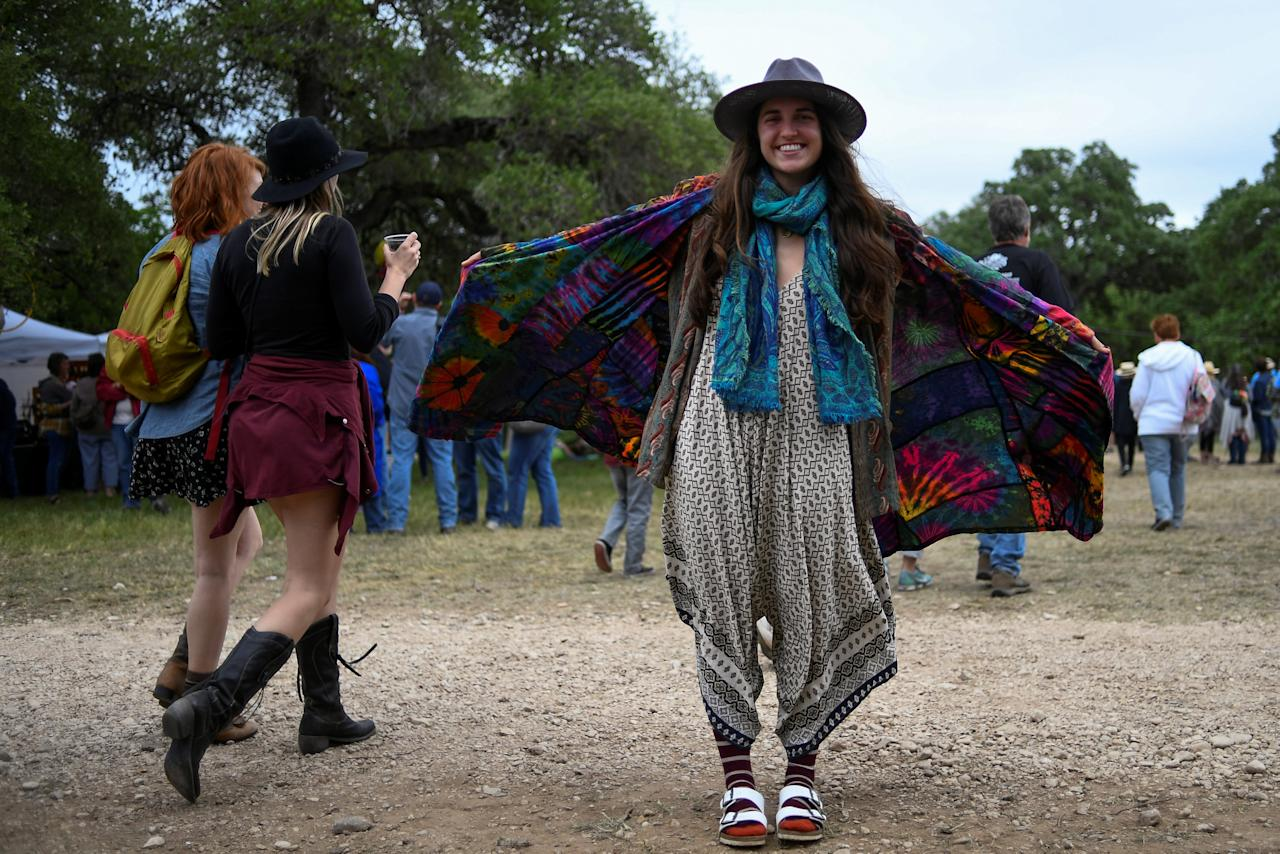 A woman shows her fashion at the Old Settler's Music Festival in Driftwood, Texas, U.S. on April 22, 2017.   REUTERS/Mohammad Khursheed