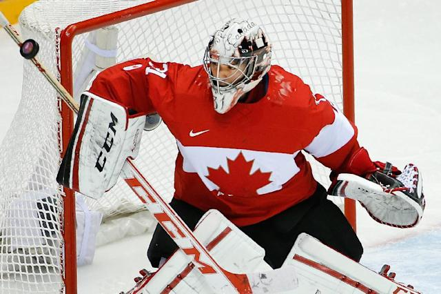 Canada goaltender Carey Price blocks a shot on the goal during the third period of the men's semifinal ice hockey game at the 2014 Winter Olympics, Friday, Feb. 21, 2014, in Sochi, Russia. (AP Photo/Matt Slocum)