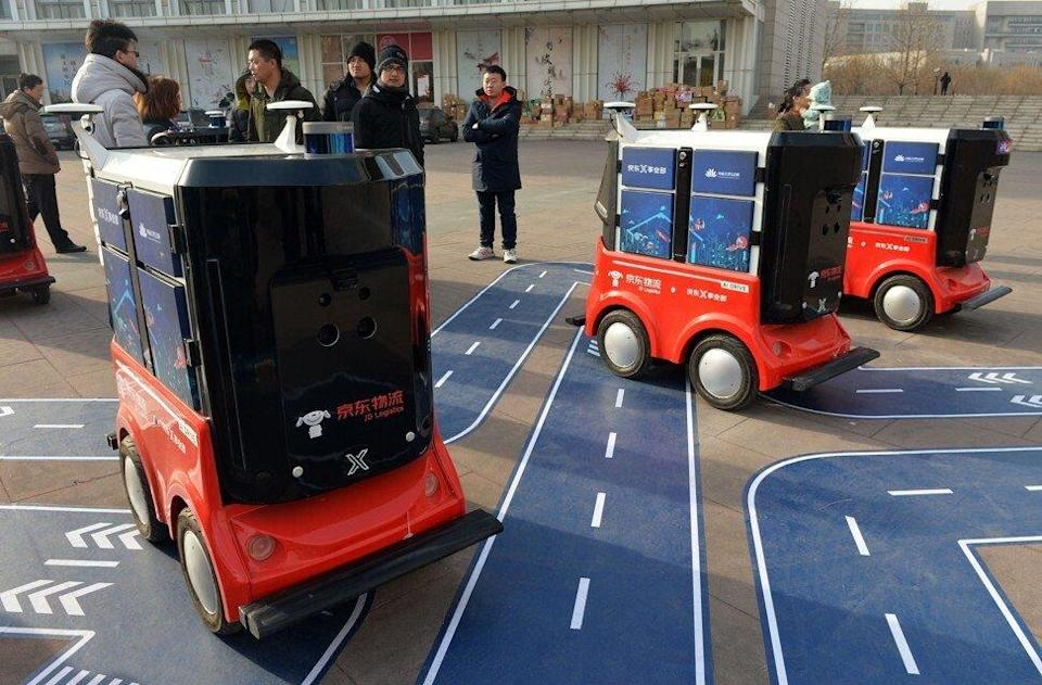 Driverless delivery vehicles under JD Logistics are shown during tests held at the Sino-Singapore Tianjin Eco-City in northern China on January 18, 2018. Photo: Agence France-Presse