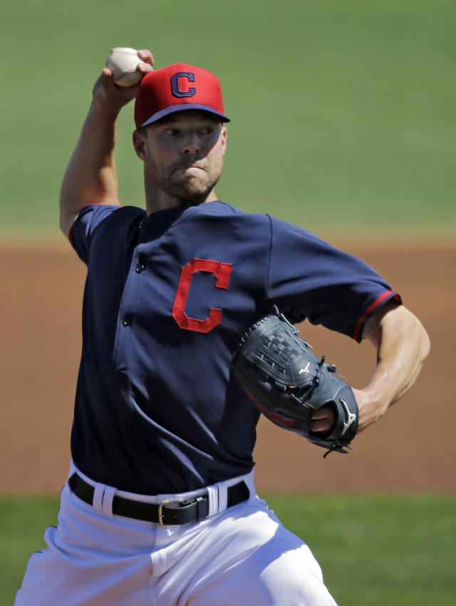 Cleveland Indians starting pitcher Corey Kluber delivers against the Colorado Rockies in a spring exhibition baseball game Saturday, March 22, 2014, in Goodyear, Ariz. (AP Photo/Mark Duncan)